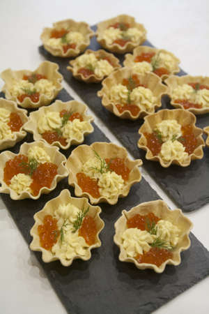 Home-made bread tartlets for fish caviar snacks and egg yolk sauce
