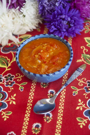 Bulgarian pepper in tomato sauce - sauce of paprika, hot chili peppers and tomatoes
