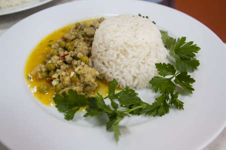 Serving dishes in the kitchen with rice meat vegetables greens Imagens