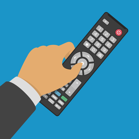 Tv remote control in hand. Vector illustration in flat style. 向量圖像