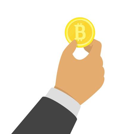 Hand holding bitcoin.
