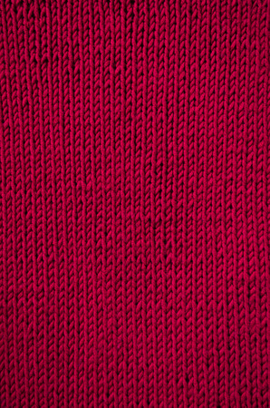 vertical orientation: Knitted red canvas pattern background. Vertical orientation