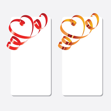 Gold and red curling ribbons in shape of heart over the greeting cards. Vertical orientation