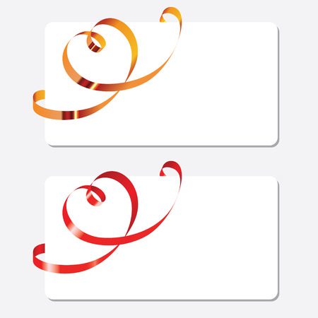 Gold and red curling ribbons in shape of heart over the greeting cards. Horizontal orientation