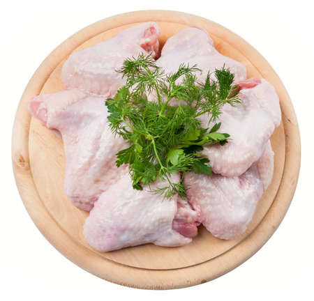 raw chicken: Raw chicken wings on a wooden round board