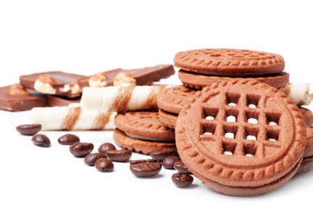 Cookies, chocolate and coffee beans on a white background Stock Photo - 13776838