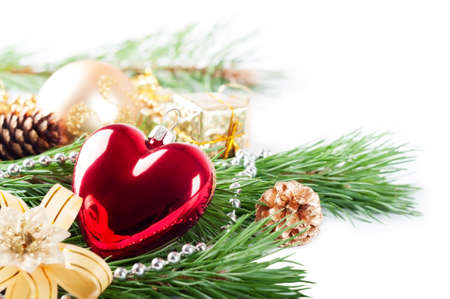 Christmas background with red heart, decorations and pine branch