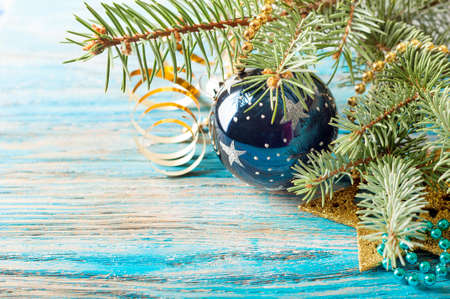 Christmas decorations and fir branch on a blue wooden background Stock Photo