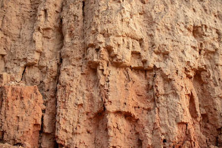 Texture of different layers of clay in clay cliff, photography. Background clay wall or clay cliff, photo