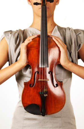 Old violin in woman hands with out face photo