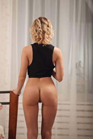 Sensual blonde woman posing in black sexy lingerie studio Stock Photo