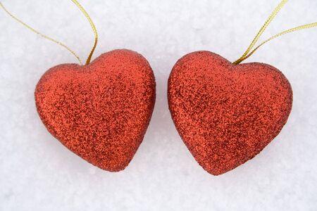twain: Two heart on snow Stock Photo