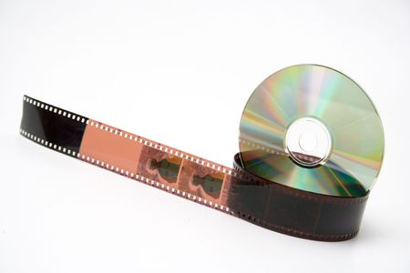 35 mm film and disk on white background. Evolution. Stock Photo - 448607