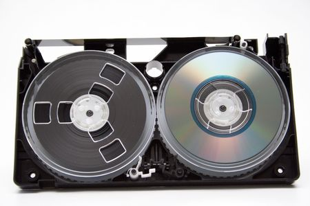 gigabytes: Take to pieces VHS cassette and CD disc on white background Stock Photo