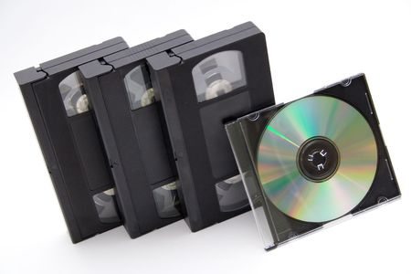 VHS cassettes and CD disc on white background photo
