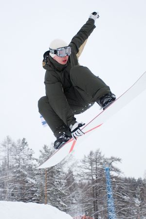 Ekstremaly. Persons rides and jumps on snowboard. photo