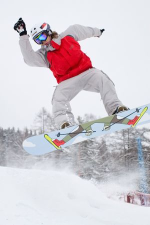 Ekstremaly. Persons rides and jumps on snowboard. Stock Photo - 747874