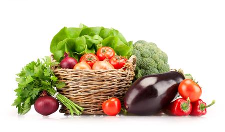 Full basket of ripe vegetables on white background