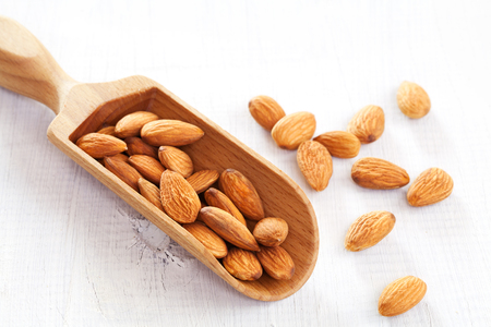 Almond on white wooden table