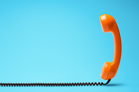 Telephone in retro style on blue background.
