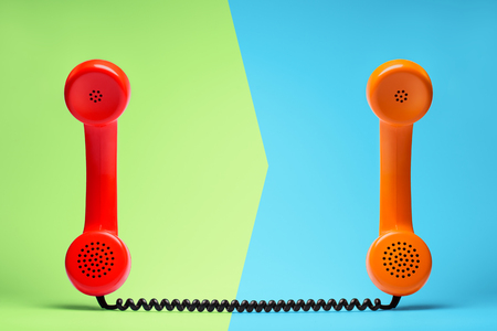 Red and orange telephone in retro style. Stock Photo