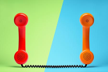 Red and orange telephone in retro style. Stock Photo