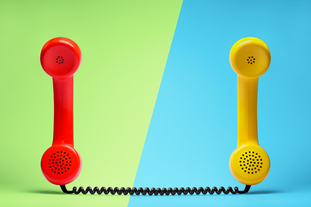Red and yellow telephone in retro style.