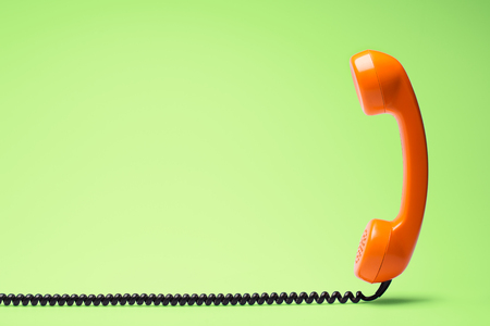 Telephone in retro style on green background.