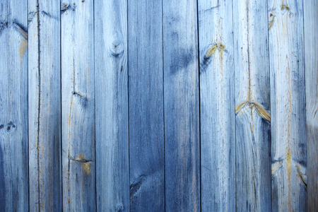 old faded blue wooden background