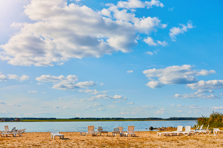 Sun loungers on the deserted river beach. Place of rest in Russia