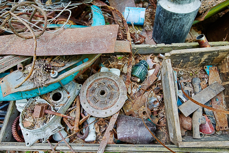 Dump old metal objects in the woods, rusty scrap metal.  Environmental destruction and pollution.