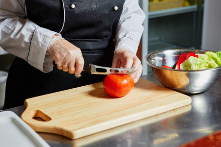 Cutting Tomato on Chopping Board,Closeup