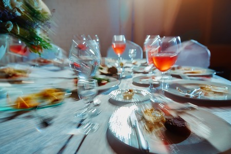Banquet table with food, as he sees a drunk man, an alcoholic who drank a lot of alcoholic beverages