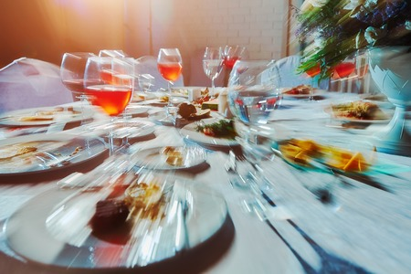 Banquet table with food, as he sees a drunk man, an alcoholic who drank a lot of alcoholic beverages.