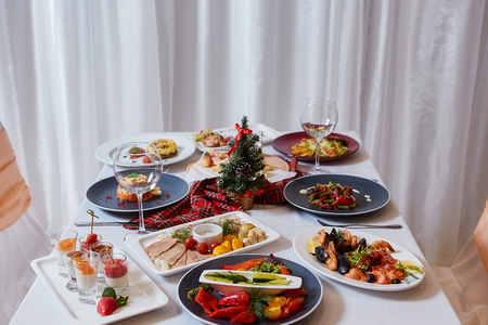 Christmas Dinner. A table in the restaurant, served for two people, is ready for the New Year.