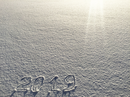 2019. Writings on the snow. Happy new year. Beautiful cold sunny winter day.  The game of light and shadow