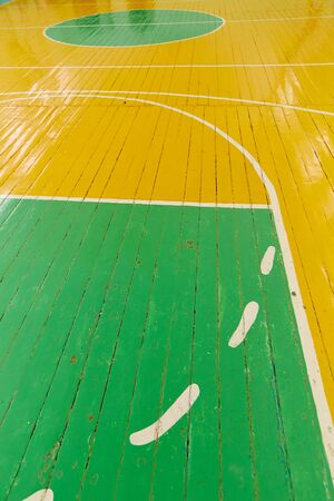 Old cracked floor of the sports hall with markings for basketball. Reklamní fotografie