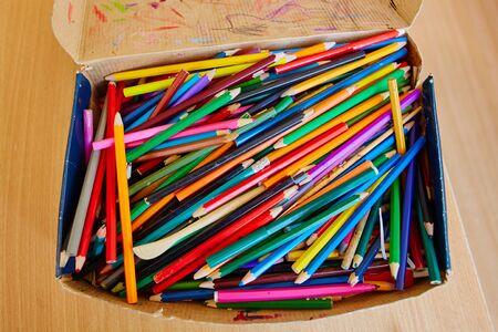 A big pile of school colored wooden pencils.