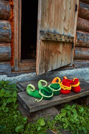 The dwarfs came home and took off his shoes at the threshold of an old wooden house.