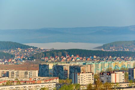 Residential complex in the Northern part of Miass, Russia. In the background, the Ural mountains, Ilmen ridge and the village of Turgoyak, near lake Turgoyak.