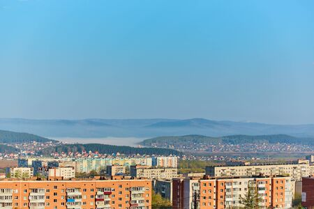 Residential complex in the Northern part of Miass, Russia. In the background, the Ural mountains, Ilmen ridge and the village of Turgoyak, near lake Turgoyak