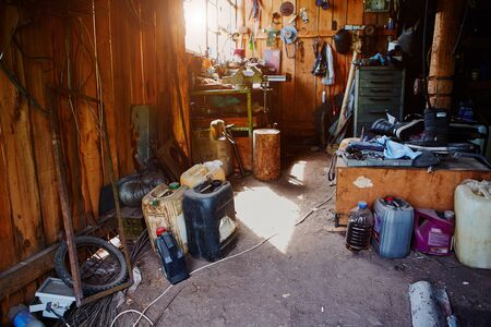 Workshop, shed, garage or storage room with tools for repair, chores, spare parts from various equipment Imagens