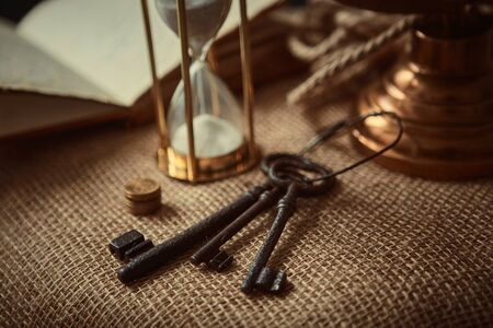Old globe, coins, magnifying glass, keys to chests, rope, pirate map and marine logbook. Travel and marine prints background. The concept of a treasure hunter. Vintage style