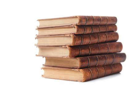 A stack of old books bound in brown leather, isolated on a white background. Space for text.