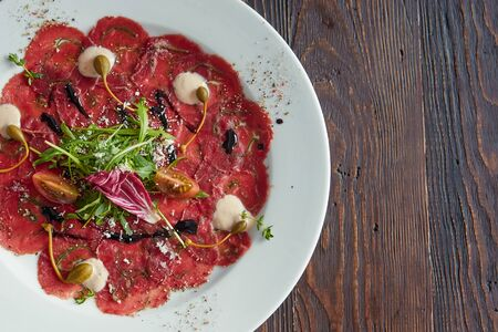 Marbled beef carpaccio. Top view, flat lay.