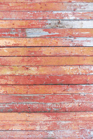 red and brown old Board with cracks from old paint, vintage grunge style with cracked surface background for your text, decoration or advertising template, retro art.
