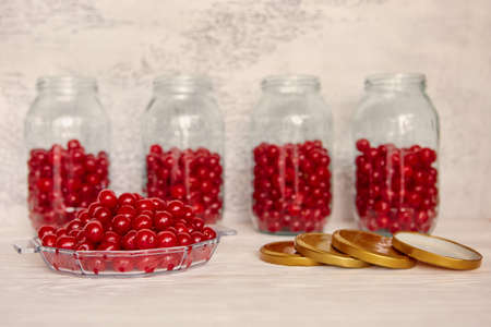 Production of cherry compote in jars. Homemade canned food. The concept of handmade