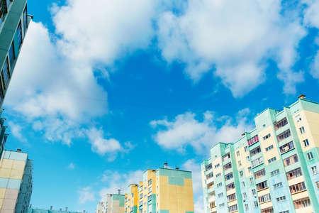 Urban landscape. New identical multi-storey apartment buildings against the blue sky.