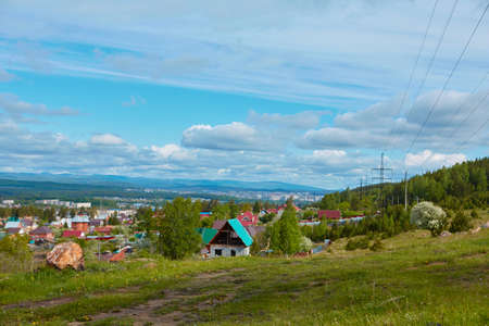 View of the old part of the city of Miassa. It is located in the southern part of the city. In the background you can see the mountain ranges of the southern Urals.