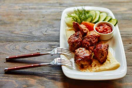 Kebab - grilled meat and vegetables.